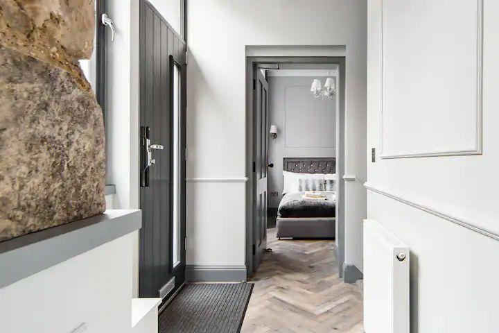 """<p>Want something sleek and historic in Scotland's capital? Try this stylish Airbnb in Edinburgh, where you can comfortably relax in a unique home away from home. There are original stone walls combined with a luxurious and modern design to give you a taste of history and the finer things in life. You'll find high-end furnishings, luxury linens and a great base that's close enough for you to walk to the city's attractions while far enough from the buzz of the centre.</p><p><strong>Sleeps: </strong>Four</p><p><a class=""""link rapid-noclick-resp"""" href=""""https://airbnb.pvxt.net/e4R6ED"""" rel=""""nofollow noopener"""" target=""""_blank"""" data-ylk=""""slk:SEE INSIDE"""">SEE INSIDE</a></p>"""