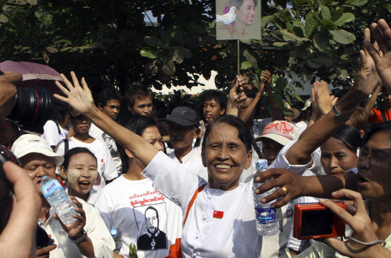 A supporter of Myanmar's detained opposition leader Aung San Suu Kyi cheers to photographers at the headquarters of her National League for Democracy (NLD) Saturday, Nov. 13, 2010 in Yangon, Myanmar. Suu Kyi's supporters gathered near her home and at her party's headquarters Saturday, hoping to see the Nobel Peace Prize laureate taste freedom after seven years of detention by Myanmar's ruling generals. (AP Photo/Khin Maung Win)