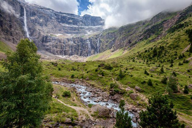 The Cirque de Gavarnie is a cirque in the central Pyrenees, in Southwestern France, close to the border of Spain. It is within the commune of Gavarnie, the department of Hautes-Pyrénées, and the Pyrénées National Park. Major features of the cirque are La Brèche de Roland (English: Roland's Pass) and the Gavarnie Falls. It was described by Victor Hugo as