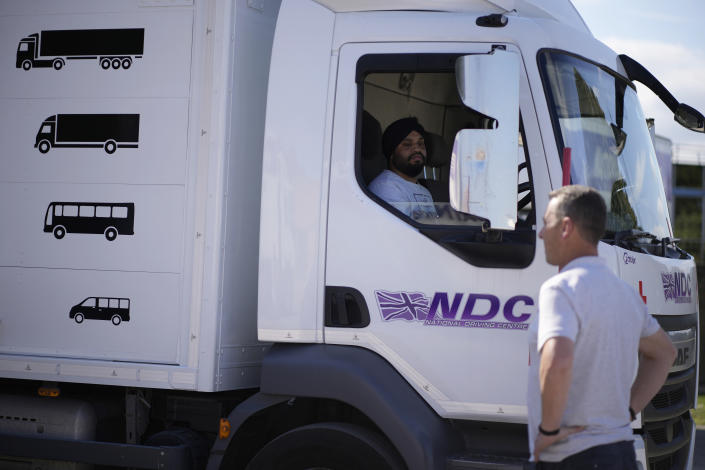 An instructor watches as a learner truck driver practices reversing at the National Driving Centre in Croydon, south London, Wednesday, Sept. 22, 2021. Britain doesn't have enough truck drivers. The shortage is contributing to scarcity of everything from McDonald's milkshakes to supermarket produce. (AP Photo/Matt Dunham)