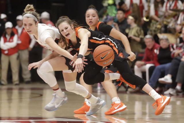 Oregon State guard Kat Tudor, middle, loses the ball while defended by Stanford guard Lexie Hull during the second half of an NCAA college basketball game in Stanford, Calif., Friday, Feb. 21, 2020. (AP Photo/Jeff Chiu)