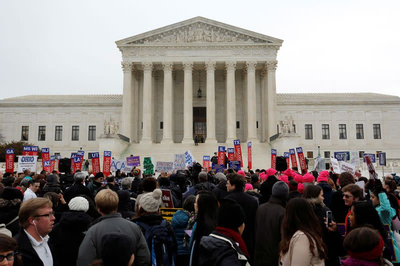 FILE PHOTO: Demonstrators in favor of Obamacare gather at the Supreme Court building in Washington