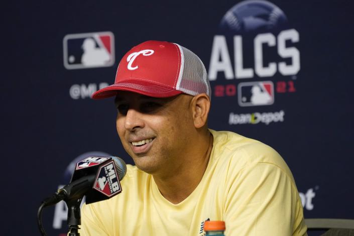 Boston Red Sox manager Alex Cora smiles as he responds to questions during a news conference before baseball practice in Houston, Thursday, Oct. 14, 2021. The Red Sox play the Houston Astros in Game 1 of the American League Championship Series on Friday. (AP Photo/Tony Gutierrez)