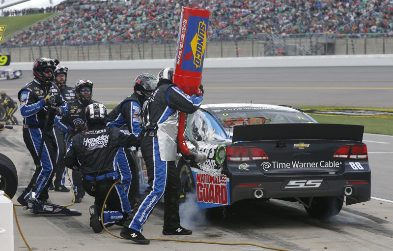 Driver Dale Earnhardt Jr. (88) pits during a NASCAR Sprint Cup series auto race at Kansas Speedway in Kansas City, Kan., Sunday, Oct. 6, 2013. (AP Photo/Orlin Wagner)