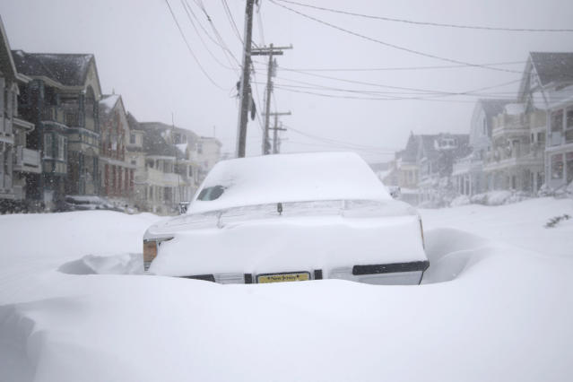 <p>A vehicle parked on Abbott Avenue is engulfed by snowdrifts during a snowstorm that hit the New Jersey Shore, Thursday, Jan. 4, 2018, in Ocean Grove, N.J. (Photo: Julio Cortez/AP) </p>