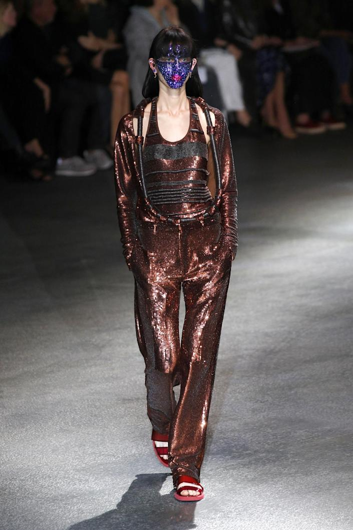 A model presents a creation as part of Givenchy's ready-to-wear Spring/Summer 2014 fashion collection, presented Sunday, Sept. 29, 2013 in Paris. (AP Photo/Christophe Ena)