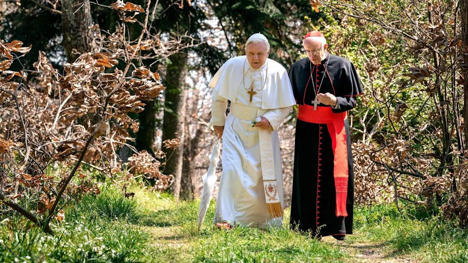<p> Cardinal Jorge Mario Bergoglio, later Pope Francis, and Pope Benedict XVI have an interesting relationship. There were disagreements in the way the Church should be run, with Pope Benedict having more classical beliefs. And yet, Benedict also became the first Pope to renounce his position since 1415, with Pope Francis taking over.&#xA0; </p> <p> What happened? That&apos;s the question this wholesome movie about faith attempts to answer, painting a pleasant portrait of two men at odds coming to an understanding. Even if you&apos;re not religious, The Two Popes makes for a light watch that&apos;s enhanced drastically by two incredible central performances: Jonathan Pryce as Pope Francis and Anthony Hopkins as Pope Benedict. They were both rightly nominated for Oscars. </p>