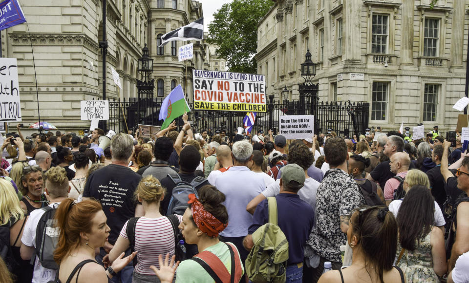 Protesters gather outside Downing Street during the anti-lockdown rally in London. Anti-lockdown, anti-vaccine and anti-mask protesters gathered outside the Houses of Parliament and Downing Street as the government announced that lifting further COVID-19 restrictions will be delayed until July 19th. (Photo by Vuk Valcic / SOPA Images/Sipa USA)