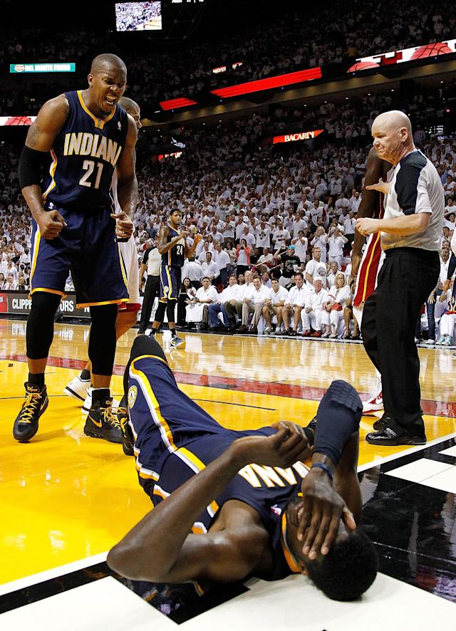 MIAMI, FL - MAY 15: David West #21 of the Indiana Pacers encourages Roy Hibbert #55 to get up during Game Two of the Eastern Conference Semifinals in the 2012 NBA Playoffs against the Miami Heat at AmericanAirlines Arena on May 15, 2012 in Miami, Florida. NOTE TO USER: User expressly acknowledges and agrees that, by downloading and/or using this Photograph, User is consenting to the terms and conditions of the Getty Images License Agreement. (Photo by Mike Ehrmann/Getty Images)