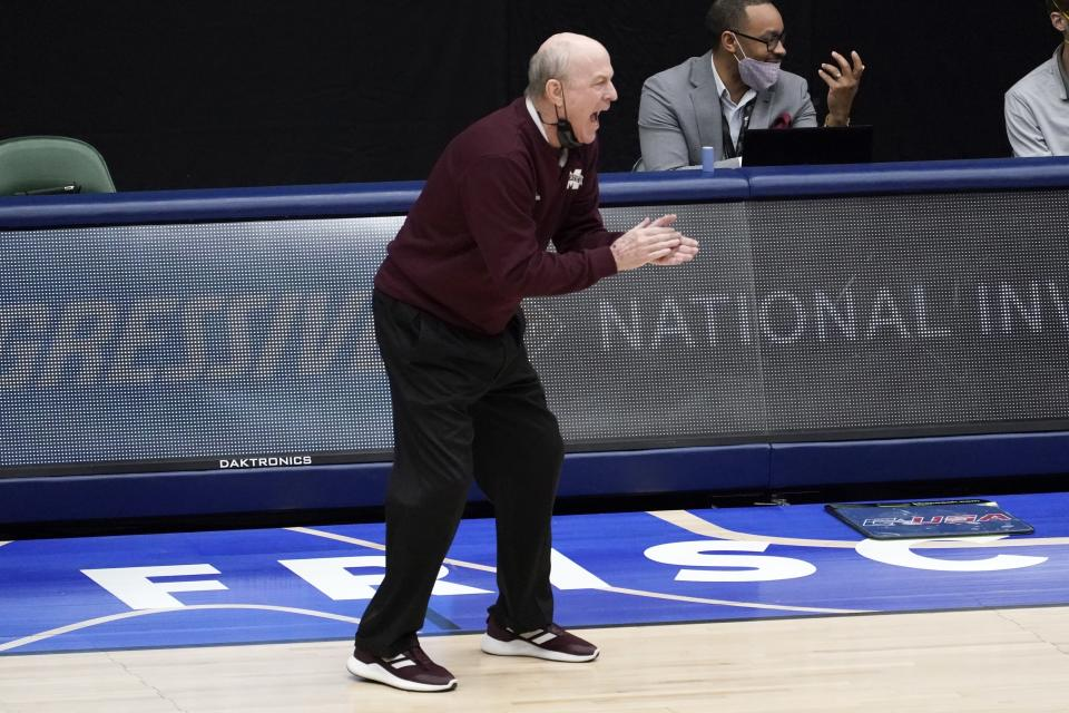 Mississippi State head coach Ben Howland applauds his team in the first half of an NCAA college basketball championship game against Memphis in the NIT, Sunday, March 28, 2021, in Frisco, Texas. (AP Photo/Tony Gutierrez)