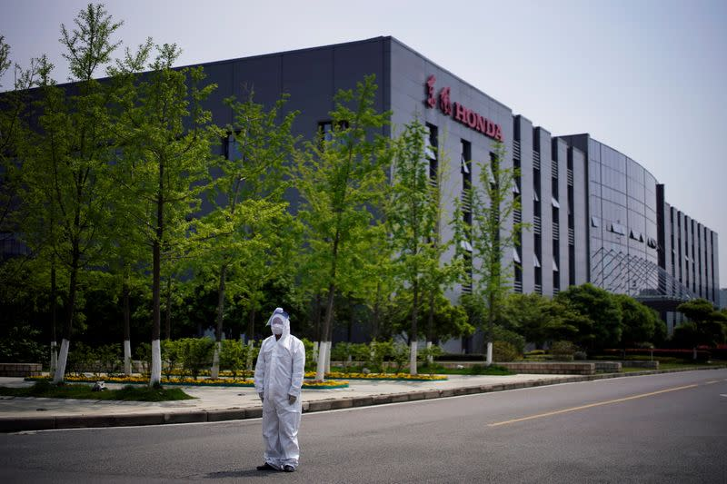 Worker in a protective suit is seen at a Dongfeng Honda factory in Wuhan
