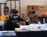 FILE PHOTO: Employees of the Fulton County Board of Registration and Elections process ballots in Atlanta