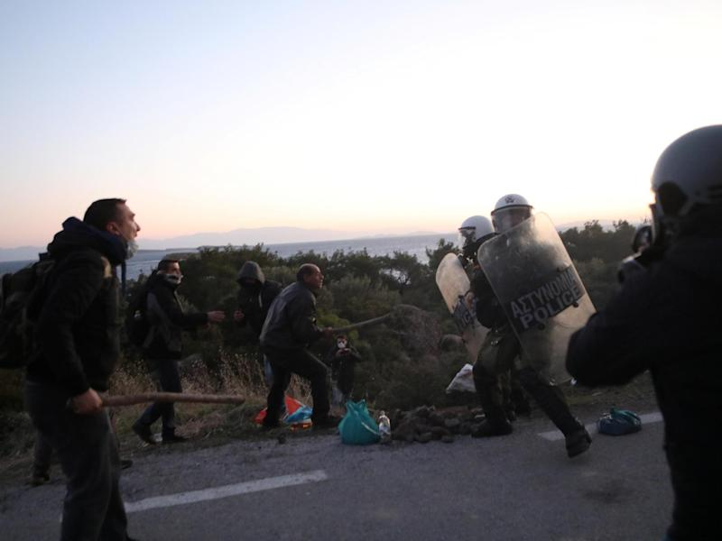 Locals scuffle with riot police on Lesbos during protests against a planned new migrant centre: Reuters