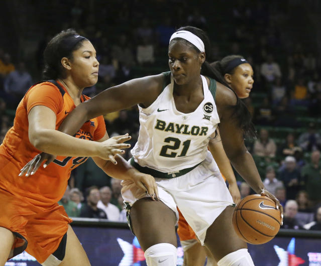 FILE - In this Wednesday, Jan. 31, 2018 file photo,Baylor center Kalani Brown, right, drives on Oklahoma State center Kaylee Jensen, left, during the second half of an NCAA college basketball game in Waco, Texas. (AP Photo/Rod Aydelotte, File)