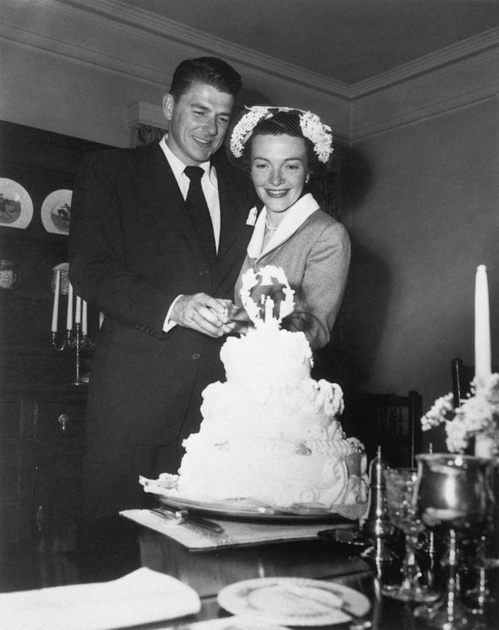 """<p>When Ronald and Nancy Reagan said """"I do,"""" the couple were still a long way from the White House. The Hollywood stars had a small <a href=""""https://www.vogue.com/article/weddings-nancy-reagan-ronald-reagan-marriage-love"""" rel=""""nofollow noopener"""" target=""""_blank"""" data-ylk=""""slk:ceremony at the Little Brown Church"""" class=""""link rapid-noclick-resp"""">ceremony at the Little Brown Church</a> in Los Angeles.</p>"""