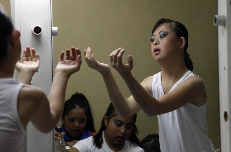 "In this Sept. 21, 2012 photo, dancer Jessica Diaz rehearses in front of a mirror ahead of her performance in ""Suenos,"" or ""Dreams,"" one of Ecuador's most successful musicals, at the Casa de la Cultura theater in Quito, Ecuador. The musical is based in part on the dreams of young people with disabilities and is presented by the nonprofit foundation El Triangulo. (AP Photo/Dolores Ochoa)"