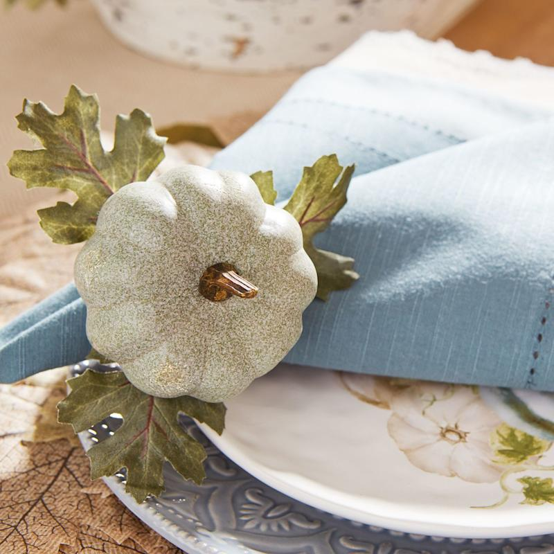 "For under $5 each, these <a href=""https://www.pier1.com/autumn-bliss-pumpkin-napkin-ring-/3217855.html?cgid=thanksgiving-dinnerware"" target=""_blank"">pumpkin napkin rings</a> are the perfect plating accent."