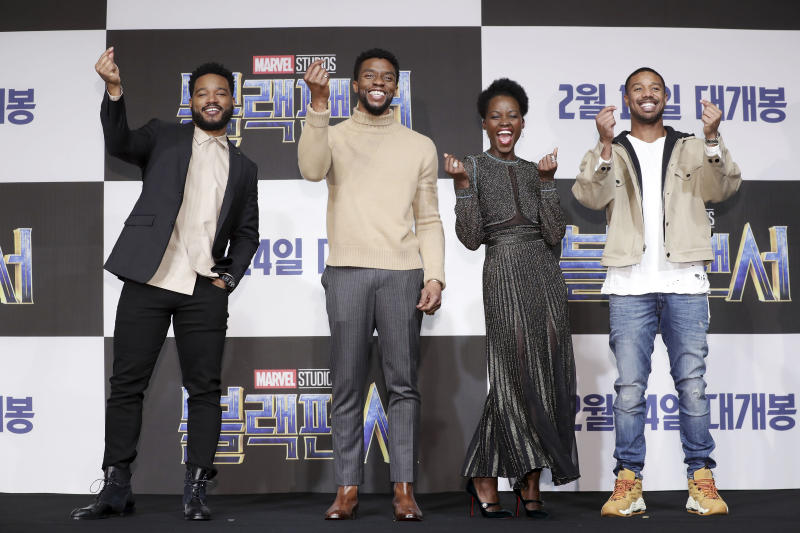 "From left, ""Black Panther"" director Ryan Coogler flashes a finger heart alongside actors Chadwick Boseman, Lupita Nyong'o and Michael B. Jordan at the Seoul premiere of their movie earlier this month. (Han Myung-Gu/Getty Images)"