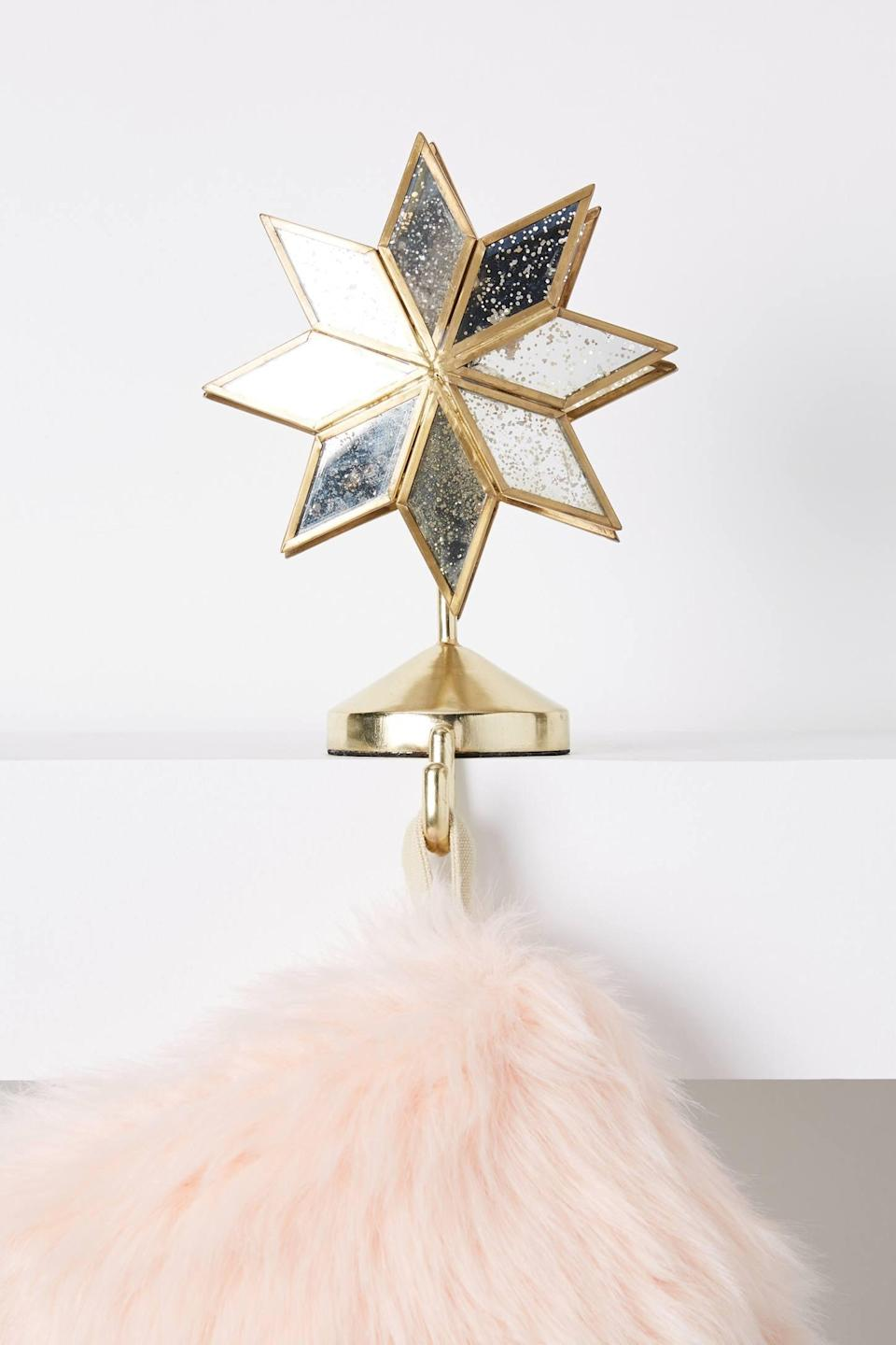 """<p>Let the stars hold your stockings this year with the <a href=""""https://www.popsugar.com/buy/North-Star-Stocking-Holder-490469?p_name=North%20Star%20Stocking%20Holder&retailer=anthropologie.com&pid=490469&price=38&evar1=casa%3Aus&evar9=46615300&evar98=https%3A%2F%2Fwww.popsugar.com%2Fhome%2Fphoto-gallery%2F46615300%2Fimage%2F46615339%2FNorth-Star-Stocking-Holder&list1=shopping%2Canthropologie%2Choliday%2Cchristmas%2Cchristmas%20decorations%2Choliday%20decor%2Chome%20shopping&prop13=mobile&pdata=1"""" rel=""""nofollow noopener"""" class=""""link rapid-noclick-resp"""" target=""""_blank"""" data-ylk=""""slk:North Star Stocking Holder"""">North Star Stocking Holder</a> ($38).</p>"""