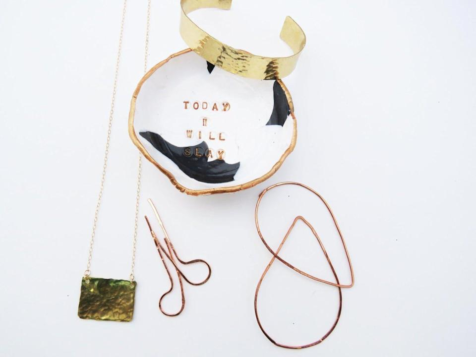 """<p><strong>thepinklocket</strong></p><p>etsy.com</p><p><strong>$22.00</strong></p><p><a href=""""https://go.redirectingat.com?id=74968X1596630&url=https%3A%2F%2Fwww.etsy.com%2Flisting%2F479530824%2Fconfident-women-jewelry-dish-black-and&sref=https%3A%2F%2Fwww.housebeautiful.com%2Fshopping%2Fg1969%2Fholiday-gifts-for-women%2F"""" rel=""""nofollow noopener"""" target=""""_blank"""" data-ylk=""""slk:BUY NOW"""" class=""""link rapid-noclick-resp"""">BUY NOW</a></p><p>Trinket trays always come in handy, and this one will remind her of how amazing she is every day. </p>"""