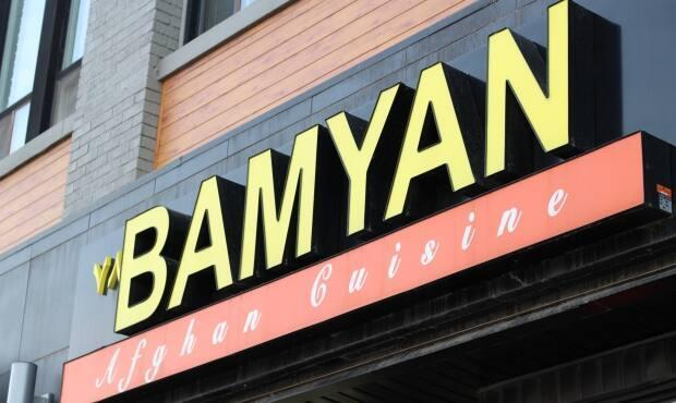 Nuriddin Amruddin, the owner of Bamyan Afghan Cuisine on Richmond Row, said his partner who was captured yelling obscenities at customers on Saturday has now been removed and asked to stay off premises. (Sara Jabakhanji/CBC - image credit)