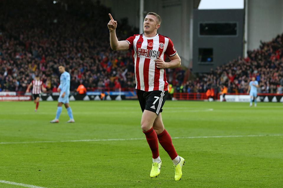 SHEFFIELD, ENGLAND - NOVEMBER 02: John Lundstram of Sheffield United celebrates after scoring his team's first goal during the Premier League match between Sheffield United and Burnley FC at Bramall Lane on November 02, 2019 in Sheffield, United Kingdom. (Photo by Nigel Roddis/Getty Images)