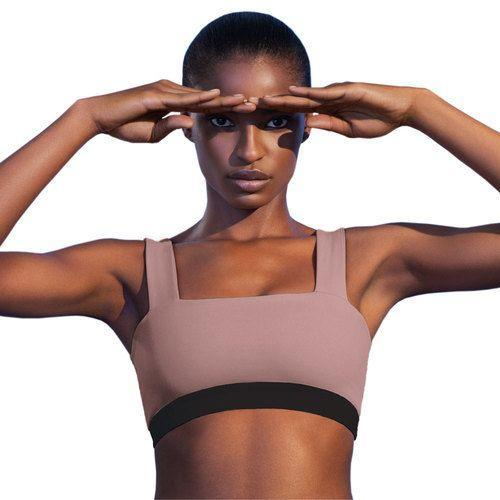 """<p>fullcourtsport.com</p><p><strong>$45.00</strong></p><p><a href=""""https://www.fullcourtsport.com/shop-2/sport-bra-top-in-mauve"""" rel=""""nofollow noopener"""" target=""""_blank"""" data-ylk=""""slk:Shop Now"""" class=""""link rapid-noclick-resp"""">Shop Now</a></p><p>If you need more support, this bra is here to answer the call. With thick (but still super cute!) straps and nylon lycra fabric, it's super-soft, but offers the maximum amount of support. It would also work really well if you wanted to wear it as a top while getting in your workout.</p>"""