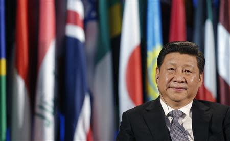 Chinese President Xi Jinping looks on during a visit at the UNESCO headquarters in Paris