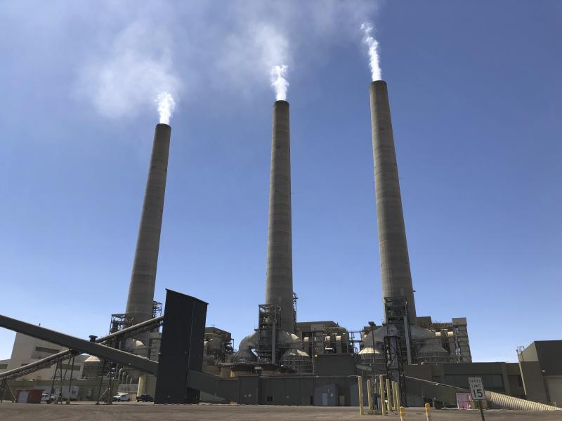 This Aug. 20, 2019, image shows a trio of concrete stacks at the Navajo Generating Station near Page, Ariz. The power plant will close before the year ends, upending the lives of hundreds of mostly Native American workers who mined coal, loaded it and played a part in producing electricity that powered the American Southwest. (AP Photo/Susan Montoya Bryan)