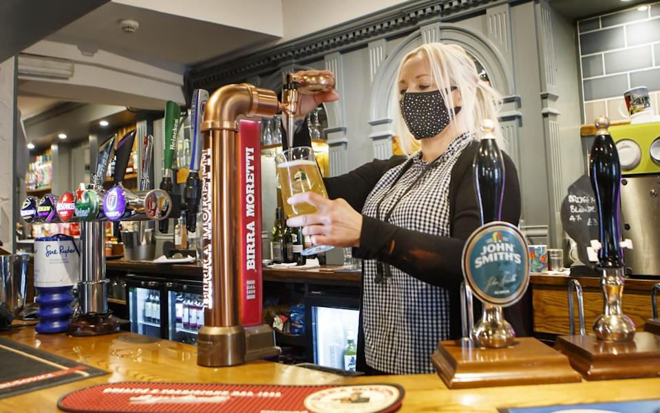 Drinks being poured at a pub