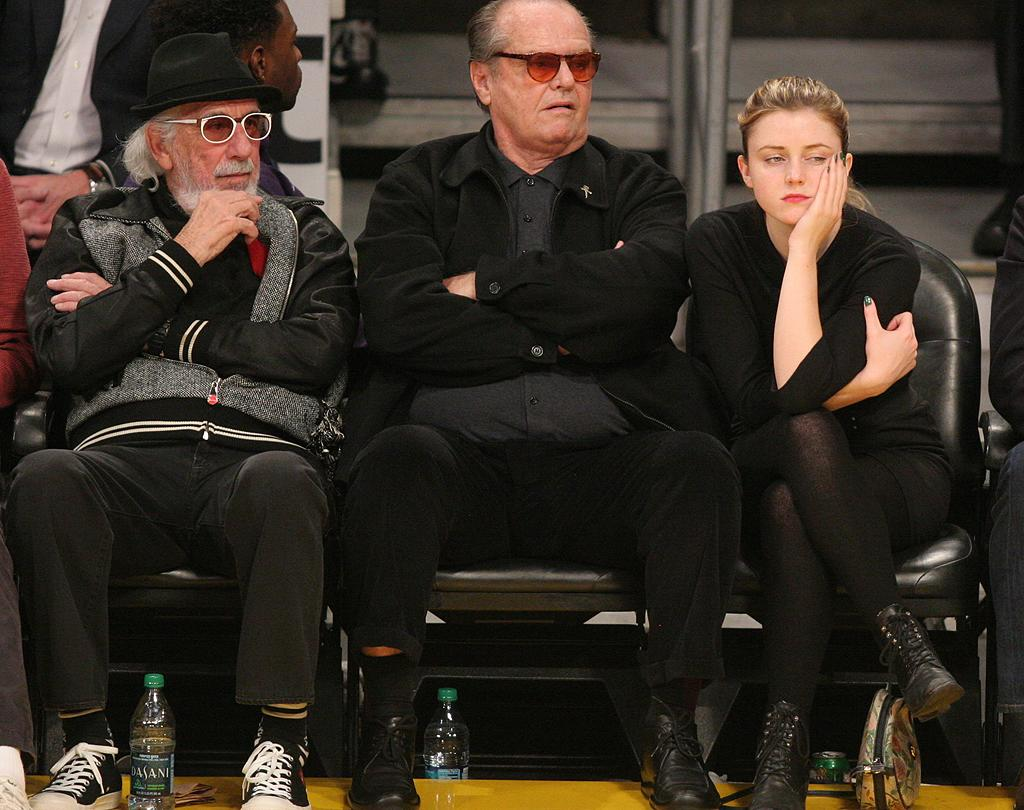 """Oscar-winning actor Jack Nicholson took his actress daughter, 21-year-old Lorraine, as his date. The """"Soul Surfer"""" starlet looked every bit as disgusted as her dad at the action on the court! (01/16/2012)"""