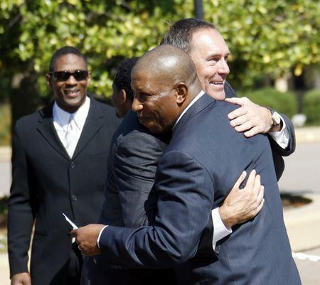 File photo: Former San Francisco 49ers great, wide receiver Dwight Clark (R) greets former teammate, running back Wendell Tyler, before the memorial for former NFL football coach Bill Walsh at Stanford Memorial Church in Stanford, California August 9, 2007. REUTERS/Dino Vournas