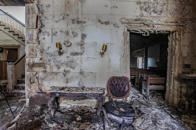 "<p><span>Urban Explorer Abandoned Southeast: ""There were also records from the funeral home itself. The oldest I saw dated back to 1896, when a funeral and burial only cost $6. </span><span>The air inside is damp and thick from the partially collapsed roof and severe water damage."" </span>(Photo: Caters News) </p>"