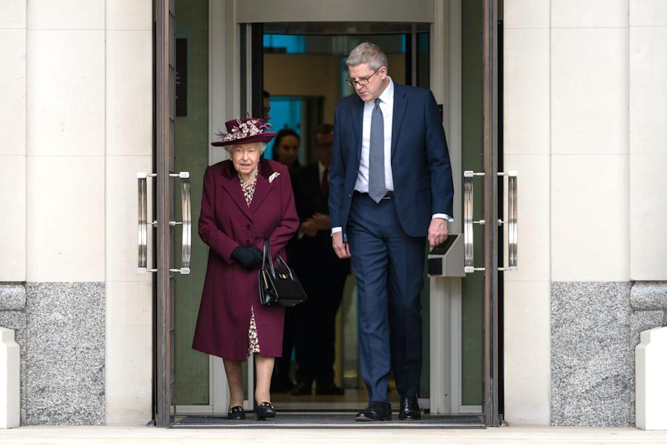 Queen Elizabeth II talks to Director General  Andrew Parker as she leaves after a visit to the headquarters of MI5 at Thames House in London. PA Photo. Picture date: Tuesday February 25, 2020. MI5 is the United Kingdom's domestic counter-intelligence and security agency. See PA story ROYAL Queen. Photo credit should read: Aaron Chown/PA Wire