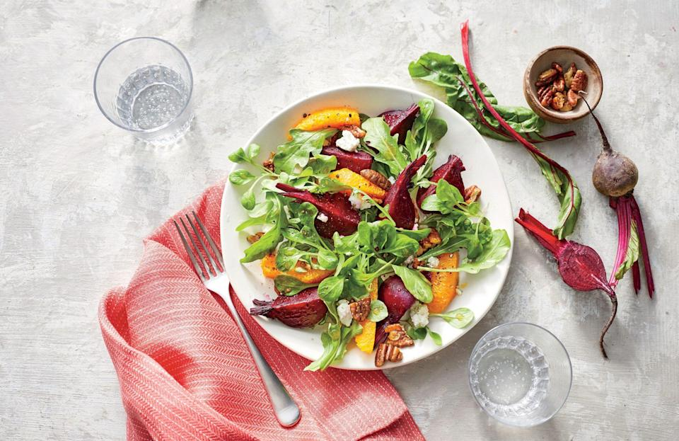 """<p><strong>Recipe: <a href=""""https://www.southernliving.com/recipes/beet-orange-salad-spiced-pecans-recipe"""" rel=""""nofollow noopener"""" target=""""_blank"""" data-ylk=""""slk:Beet-and-Orange Salad with Spicy Pecans"""" class=""""link rapid-noclick-resp"""">Beet-and-Orange Salad with Spicy Pecans</a></strong></p> <p>Sweet, savory, spicy, tangy—this is a salad that delivers on all fronts. Quality beets are essential, so pick some good ones.</p>"""