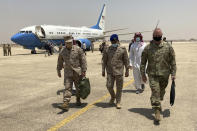 """Marine Gen. Frank McKenzie, top U.S. commander for the Middle East, left, arrives in Riyadh, Saudi Arabia, on Sunday, May 23, 2201. """"The Middle East writ broadly is an area of intense competition between the great powers. And I think that as we adjust our posture in the region, Russia and China will be looking very closely to see if a vacuum opens that they can exploit,"""" he says. (AP Photo/Lolita Baldor)"""
