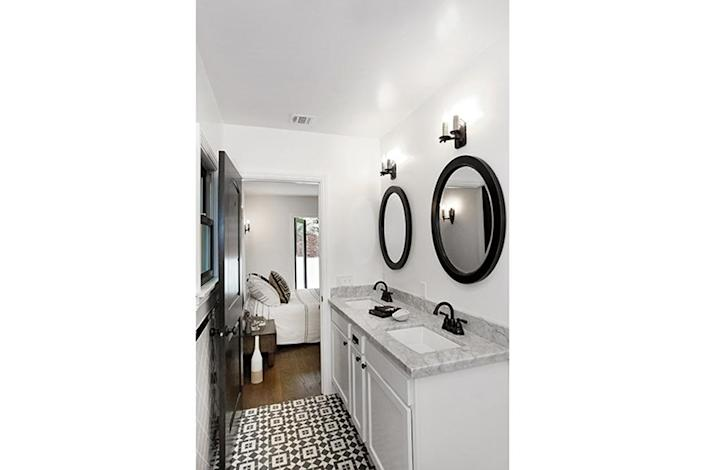 <p>Now, patterned tile complements the rest of the black-and-white bathroom scheme.<i> (Photo: Charmaine David for Kenihan Development)</i></p>