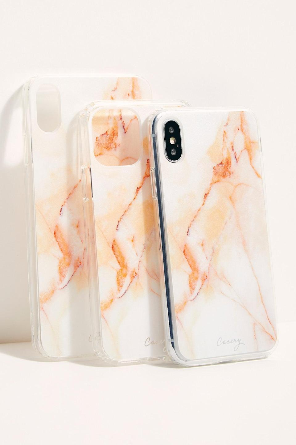 """<p>They'll love this pretty <a href=""""https://www.popsugar.com/buy/Cloudy-Marble-Phone-Case-524367?p_name=Cloudy%20Marble%20Phone%20Case&retailer=freepeople.com&pid=524367&price=32&evar1=savvy%3Aus&evar9=46975777&evar98=https%3A%2F%2Fwww.popsugar.com%2Fphoto-gallery%2F46975777%2Fimage%2F46976036%2FCloudy-Marble-Phone-Case&list1=gifts%2Cgift%20guide&prop13=api&pdata=1"""" class=""""link rapid-noclick-resp"""" rel=""""nofollow noopener"""" target=""""_blank"""" data-ylk=""""slk:Cloudy Marble Phone Case"""">Cloudy Marble Phone Case</a> ($32).</p>"""
