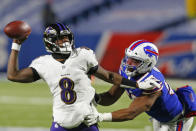 Buffalo Bills defensive end Jerry Hughes (55) pressures Baltimore Ravens quarterback Lamar Jackson (8) during the second half of an NFL divisional round football game Saturday, Jan. 16, 2021, in Orchard Park, N.Y. (AP Photo/Jeffrey T. Barnes)