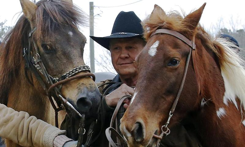 Roy Moore walks his horses after voting.