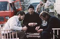<p>Producer and screenwriter Michael G. Wilson plays backgammon with Topol and Roger Moore on the set of the James Bond film 'For Your Eyes Only', 1980. </p>