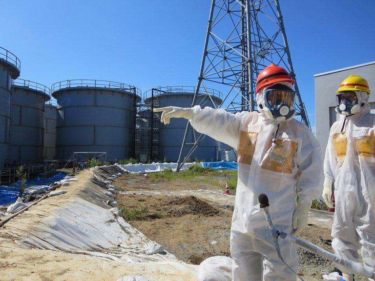 Japanese Minister Toshimitsu Motegi at TEPCO's Fukushima Dai-ichi nuclear power plant on August 26, 2013