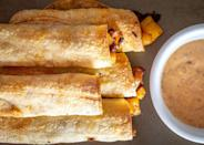 """<p>These potato chorizo taquitos are baked, not fried. The crispiness may be turned down a notch, but the flavors stay the same. Word of wisdom: resist the urge to peep inside the oven too often as your taquitos bake. Wait until about 15 minutes after the taquitos have been placed inside. Learning to let food be as it cooks is <a href=""""https://www.thedailymeal.com/cook/restaurant-secrets-every-home-cook-should-know-gallery?referrer=yahoo&category=beauty_food&include_utm=1&utm_medium=referral&utm_source=yahoo&utm_campaign=feed"""" rel=""""nofollow noopener"""" target=""""_blank"""" data-ylk=""""slk:a restaurant secret every home cook should know"""" class=""""link rapid-noclick-resp"""">a restaurant secret every home cook should know</a>. </p> <p><strong><a href=""""https://www.thedailymeal.com/best-recipes/potato-chorizo-taquitos?referrer=yahoo&category=beauty_food&include_utm=1&utm_medium=referral&utm_source=yahoo&utm_campaign=feed"""" rel=""""nofollow noopener"""" target=""""_blank"""" data-ylk=""""slk:For the Potato Chorizo Taquitos recipe, click here."""" class=""""link rapid-noclick-resp"""">For the Potato Chorizo Taquitos recipe, click here.</a></strong></p>"""