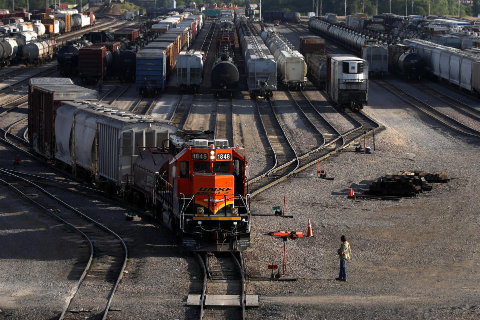 A BNSF rail terminal worker monitors the departure of a freight train Tuesday, June 15, 2021, in Galesburg, Ill. The terminal is the city's largest employer at about 1,300 workers and the second-largest rail yard for the nation's largest freight carrier. Galesburg handles 150 to 200 trains per day, sometimes eclipsing traffic at its main terminal near Kansas City, Missouri. (AP Photo/Shafkat Anowar)
