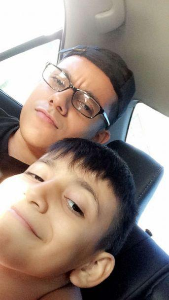 PHOTO: Adam Toledo, forefront, is pictured with his eldest brother, Marco Toledo Jr., in 2018 (Courtesy of the Toledo Family)