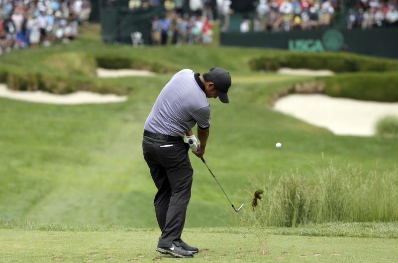 Cheng-Tsung Pan, of Taiwan, hits on the 13th hole during the first round of the U.S. Open golf tournament at Merion Golf Club, Thursday, June 13, 2013, in Ardmore, Pa. (AP Photo/Charlie Riedel)