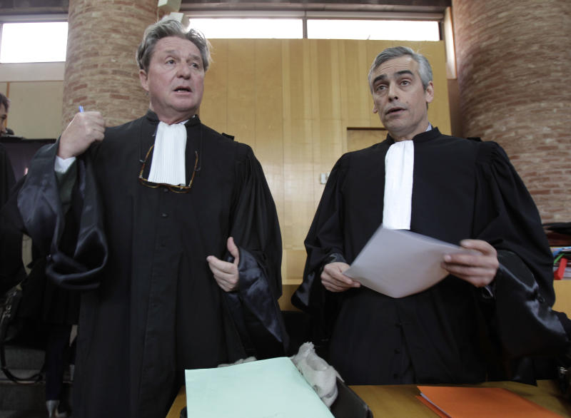 Lawyers of Henry Perrier, former head engineer of France's Concorde program, Christian Buffat, left, and Thierry Dalmasso, right, are seen the courthouse in Versailles, west of Paris, Thursday, March 8, 2012. Continental Airlines, French officials and mechanics are going back on trial over the 2000 crash of a Concorde supersonic jet, which killed 113 people. A faulty metal strip on a Continental DC-10 fell onto the runway, puncturing the Concorde's tire, sending bits of rubber into the fuel tanks and starting the fire that brought down the plane and sent it crashing into a hotel outside Paris. (AP Photo/Michel Euler)