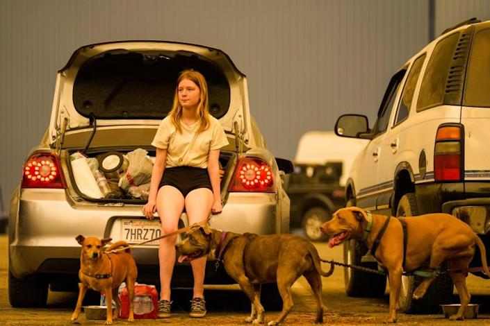 """Kelsey Mueller, 16, waits with her family to be escorted from the Creek fire evacuation zone at Shaver Lake Marina in Fresno County. <span class=""""copyright"""">(Kent Nishimura / Los Angeles Times)</span>"""