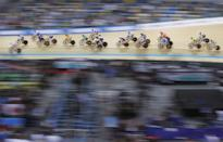 <p>Track cyclists compete in the women's scratch race at the World Track Cycling Championships in Hong Kong. (AP Images) </p>