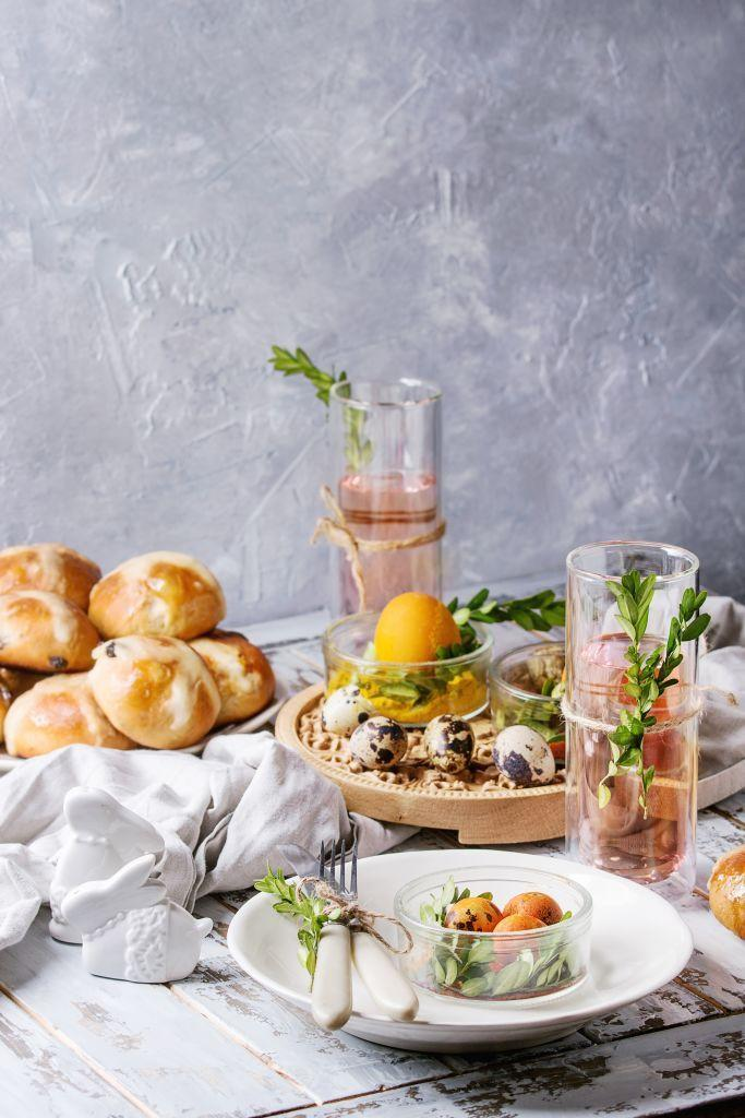 """<p>""""In our home we like to create a formal setting for Easter. We have a large gathering of family and friends, so we set up restaurant-style. We decorate each table with a centerpiece of spring flowers and candles, and everyone gets a full place setting."""" <em>—<a href=""""https://www.everickbrown.com/"""" rel=""""nofollow noopener"""" target=""""_blank"""" data-ylk=""""slk:Everick and Lisa Brown"""" class=""""link rapid-noclick-resp"""">Everick and Lisa Brown</a>, Interior Designers</em></p>"""
